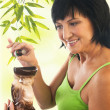 Постер, плакат: Woman with aromatherapy oil burner