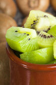 Kiwi in pot — Stock Photo