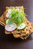 Crisp bread with radish and cucumber — Stock Photo