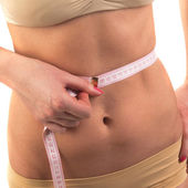 Woman measuring perfect waistline — Stock Photo