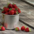 Stock Video: Ripe strawberry in a mug