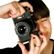 Young beautiful smiling woman holding a photo camera — Stock Photo #21733493