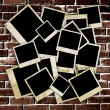 Empty old photo frames on grunge brick wall background — Stock Photo