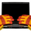 Protective gloves on a laptop isolated. Empty black desktop for - Stock Photo