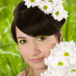 Girl with spring flowers.Glamor effect. — Stock Photo