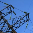 Electric pylon with a blue sky background — Stock Photo #21733483