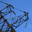 Electric pylon with a blue sky background — Stock Photo