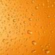 Abstract orange drops of water background — Stock Photo