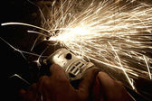 Sparks from a worker grinding steel — Stock Photo