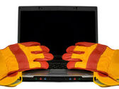 Protective gloves on a laptop isolated. — Stock Photo