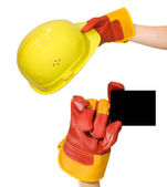 Red glove holding an empty frame and glove holding a yellow hard — Stock Photo