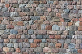 Stone wall background of natural stones — Stock Photo