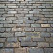 Old London cobblestone street close up. - Stock Photo