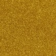 Gold glitter texture macro close up background. - Stock Photo