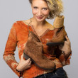 Stock Photo: Woman carry cowboys boots