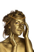 Golden woman with pearls — Stock Photo