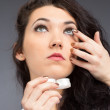 Young woman with contact lense — Stock Photo #18660597