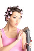 Funny girl with hair curlers on her head — Stock Photo