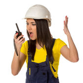 Angry worker looking to walkie-talky — Stock Photo
