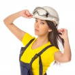 Serious female construction worker in helmet with goggles — Stock Photo