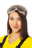 Serious female construction worker with goggles — Stock Photo