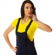Female construction worker talking with a walkie talkie — Stock Photo