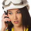 Stock Photo: Serious female construction worker talking with a walkie talkie