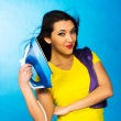 Houseworks, woman with pile of clothes for ironing — Stock Photo