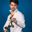Man giving the red roses — Stock Photo #26193419