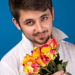 Young man giving a red rose — Stock Photo
