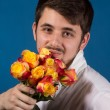 Man with bouquet of red roses — Stock Photo