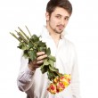 Man with bouquet of red roses. — Stock Photo #26257717
