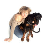 Lady and dog sitting together — Stock Photo