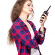 Attractive young womin checkered shirt with walkie talkie — Stock Photo #32738829