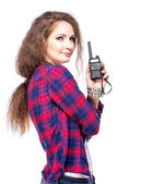 Attractive young woman in a checkered shirt with walkie talkie — Stock Photo