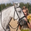 Stock Photo: Horse and butiful woman face to face