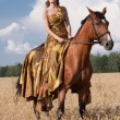 Woman with horse — Stock Photo #34784135