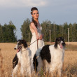 The woman in clothes of 18 centuries with dog — Stock Photo