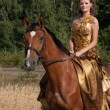Woman with horse — Stockfoto