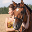 Woman with horse — Foto de stock #34786603