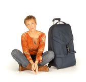 Woman sitting with suitcase on white — Stok fotoğraf