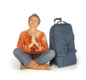 Woman sitting with suitcase — Stockfoto