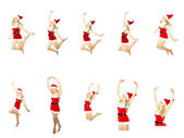 Happy smiling woman in red xmas costume jumping high, isolated — Stock Photo