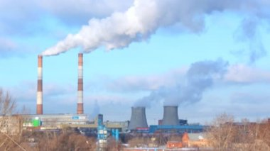 Smoking pipes of thermal power plant on blue sky — Stock Video