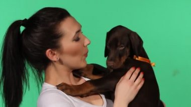 Brunette girl with her doberman puppy — Стоковое видео