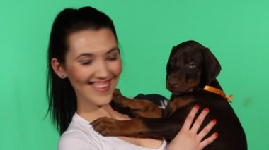 Brunette girl with her doberman puppy — Stock Video