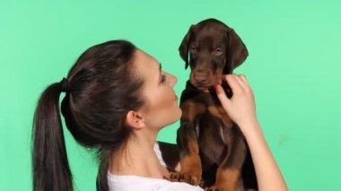 Brunette girl with her doberman puppy — Stock Video