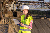 Woman working on construction site — Stock Photo