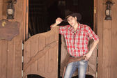 Cowboy in hat standing near saloon entrance — Stock Photo