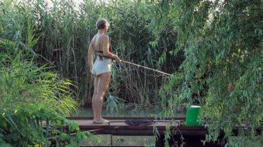 Woman fishing — Stock Video